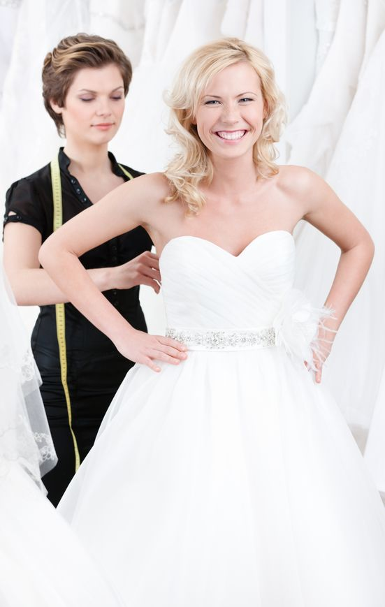 seamstress-adjusting-alterations-and-corset-on-bridal-gown